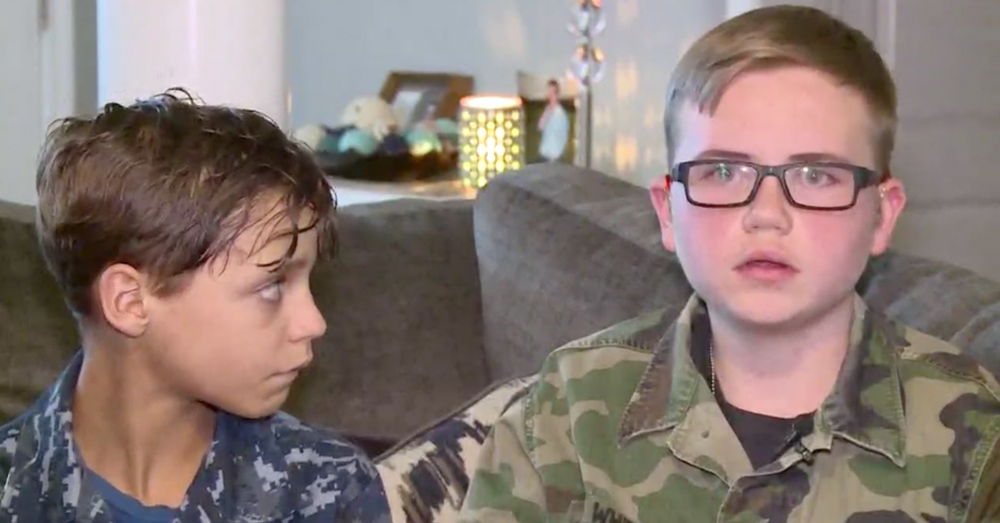 Photo: WCNC screenshot -- Nate Mills, Isaiah's neighbor, wore his grandfather's Army uniform to show his support and stop the bullying.