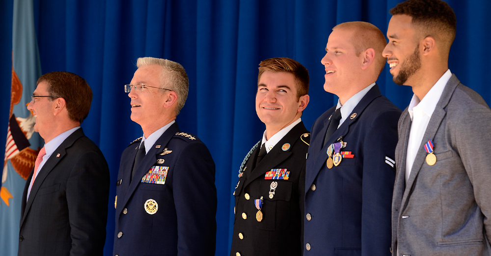 """Photo: U.S. Air Force/Scott Ash -- The """"Heroes of the Rails"""" stand during a ceremony in honor of their heroic actions."""