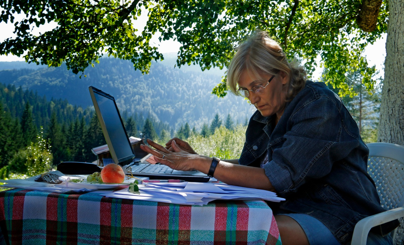Business women working outdoors on a laptop