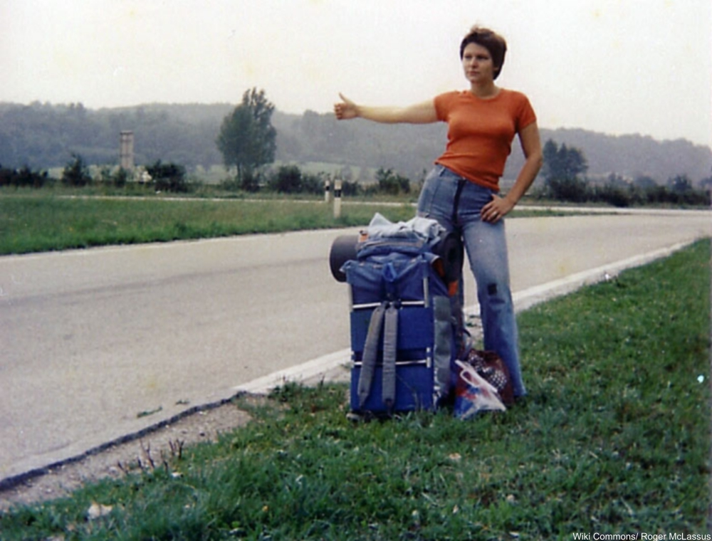 1970s woman in t-shirt hitchhiking