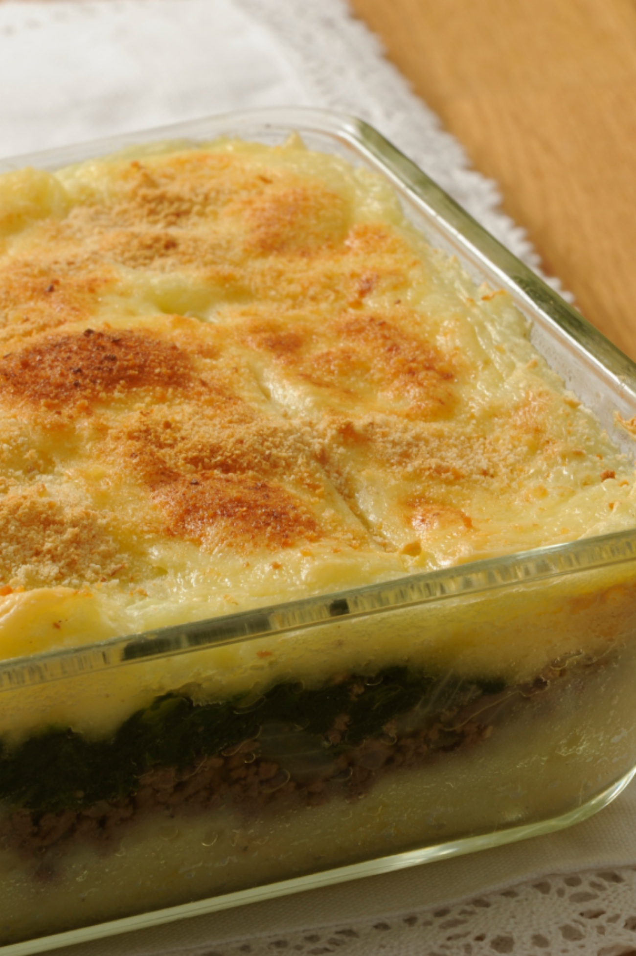 Baking dish with potato, spinach, minced meat