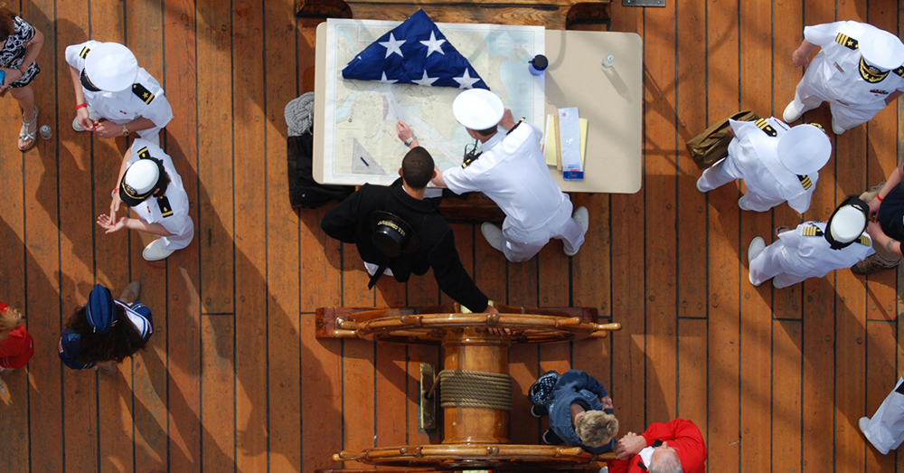 Photo: U.S. Navy/Mass Communication Specialist 3rd Class Kathryn E. Macdonald -- Seaman Jared Hutchins, left, and Lt. j.g. Gerin Choiniere plot a course for USS Constitution in Boston Harbor.