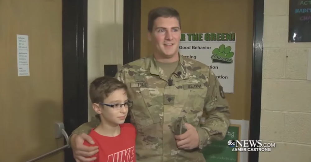 Photo: ABC News/Screenshot -- Brothers Damon Chiodo and Devon Tomei, the hero soldier, stand together after two years apart.