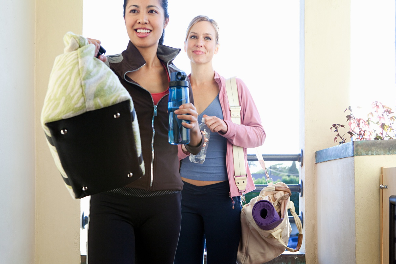 Two young women with gym bags