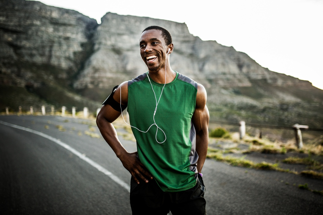African athlete smiling positively after a good training session