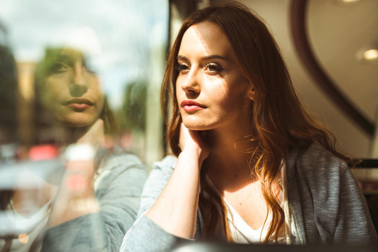 portrait of a woman inside a bus in london