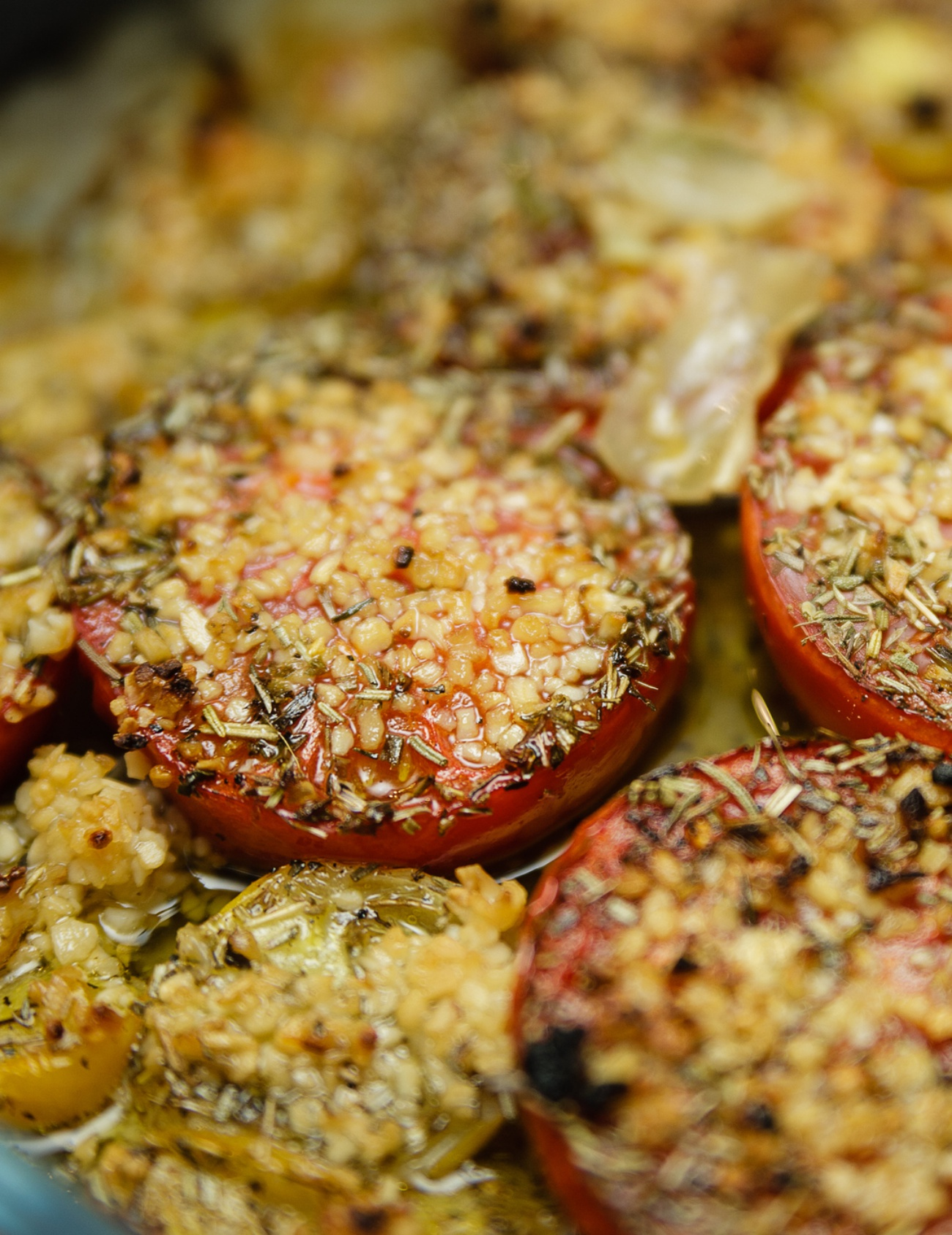 Roasted herb-crusted tomato slices close-up