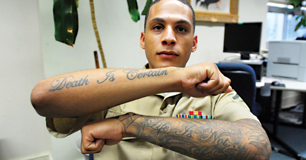 Photo: U.S. Army/Kristin Molinaro -- Marine Corps Lance Cpl. Robert Patterson displays tattoos on both arms.