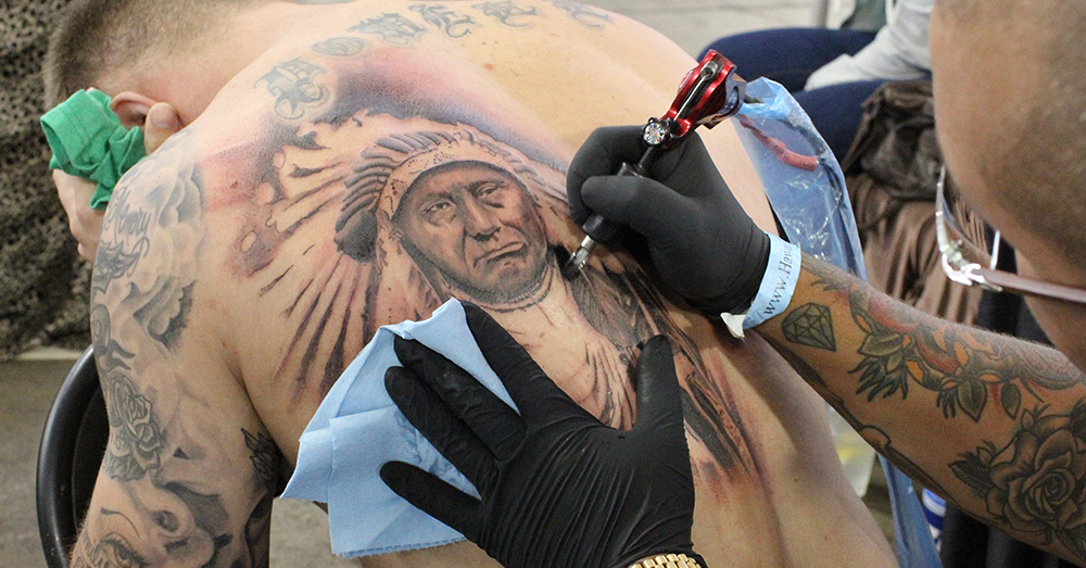 Photo: U.S. Air Force/Tech. Sgt. Phyllis Keith -- A soldier in the process of getting a large tattoo in honor of his heritage.