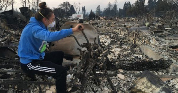 Source: GoFundMe Natasha Wallace in her neighborhood after it was destroyed by wildfires.