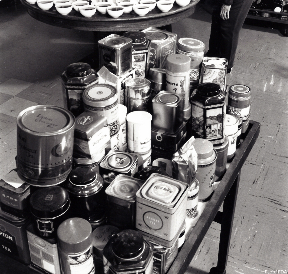 collection of tin tea caddies of all sizes