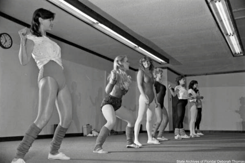 exercise class from the 1980s showing students in ballet shoes