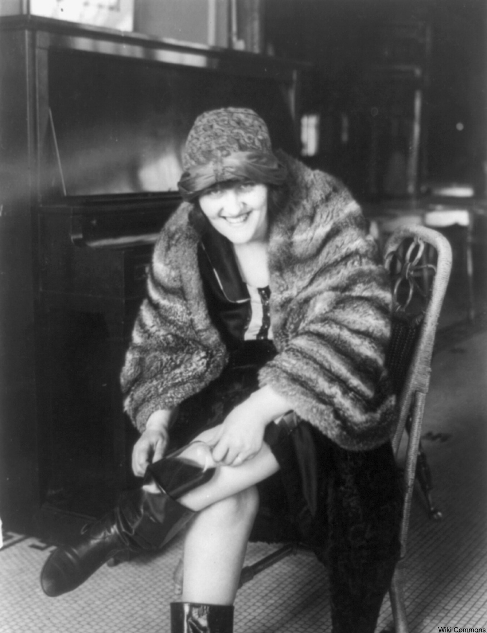 flapper slipping a flask into her boot