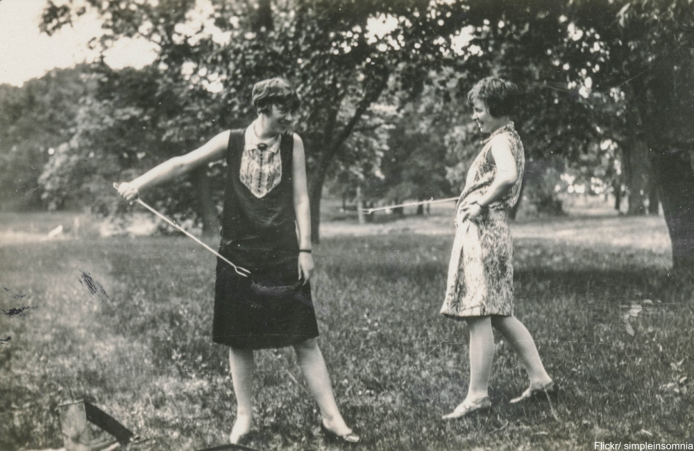 Two flappers in summer dresses