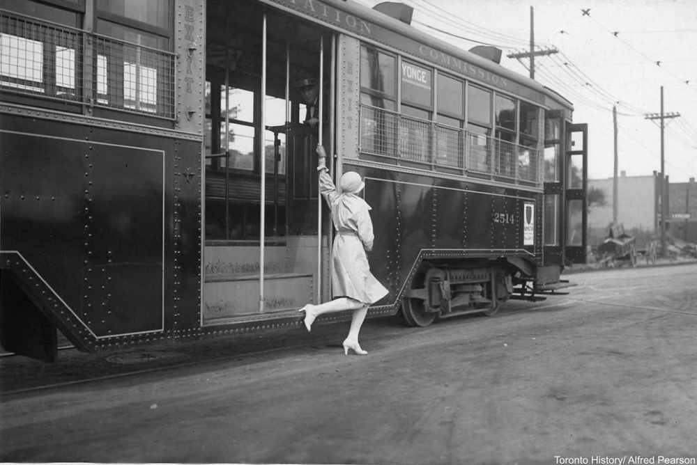 flapper trying to catch a street car