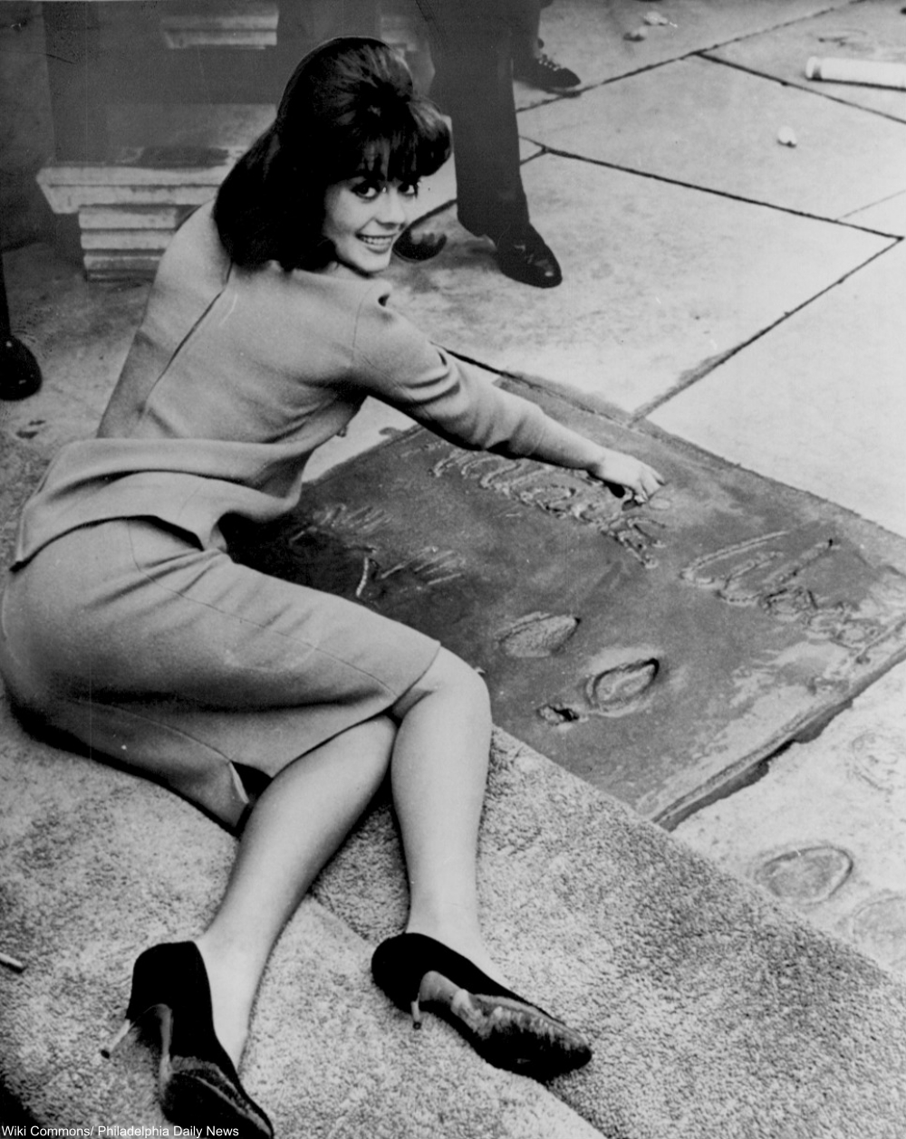 Natalie Wood putting her handprints in wet cement outside Grauman's Chinese  Theater in LA 1961