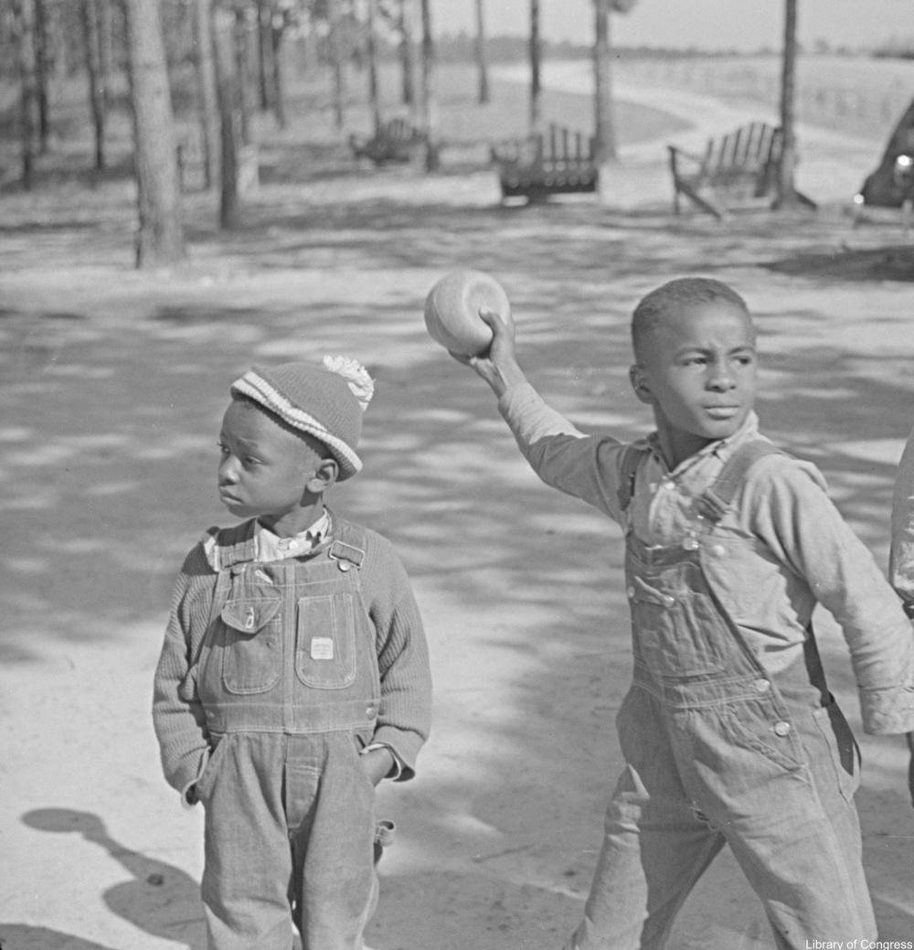 little boys playing ball 1940s
