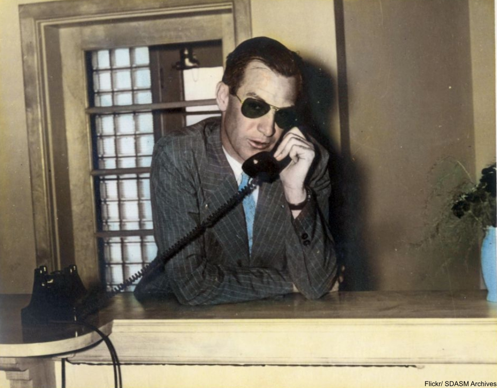 man talking on old-fashioned telelphone