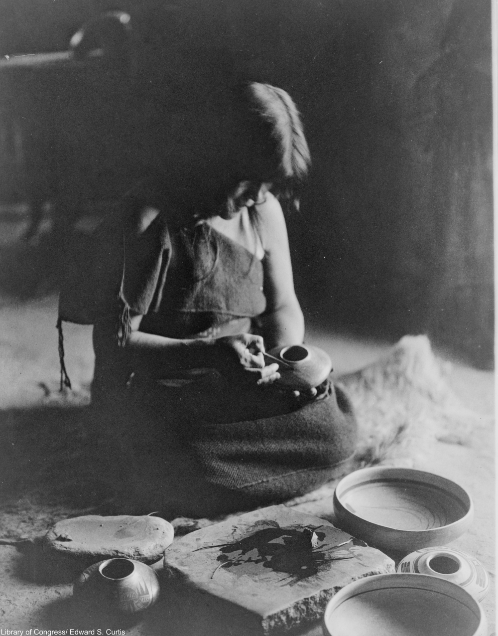 applying pigment to the pots, circa 1906
