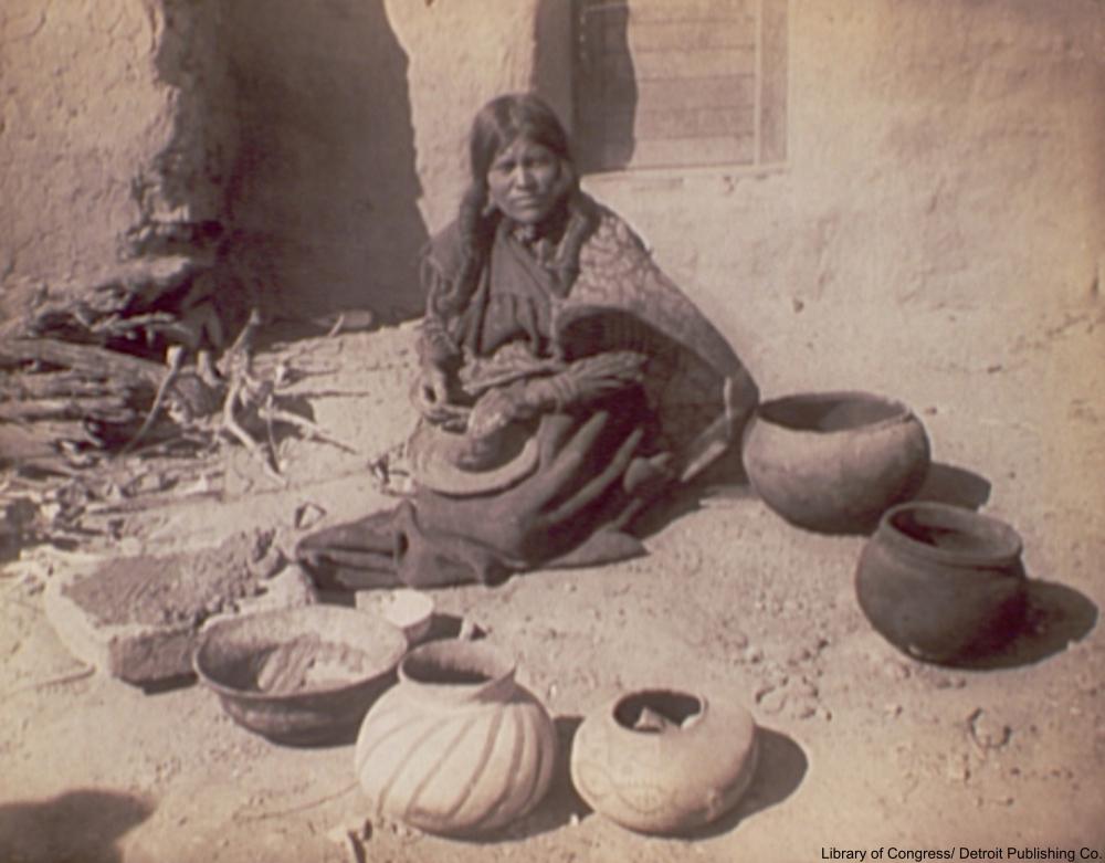 Hopi woman making pottery, circa 1900