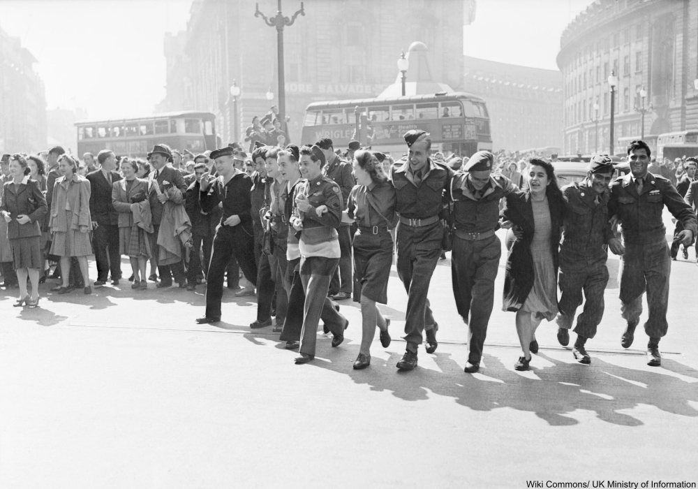 Civilians and service personnel in London's Picadilly Circus celebrate the news of Allied Victory over Japan in August 1945