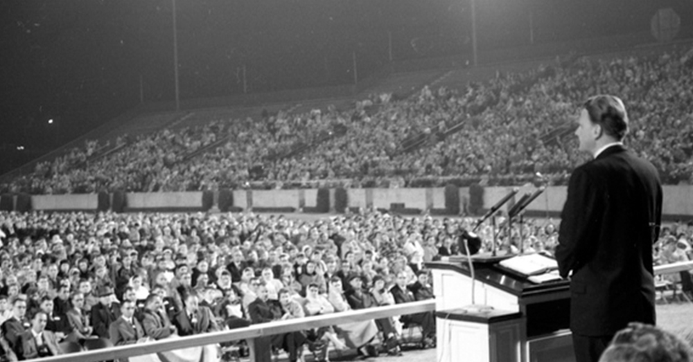 Flickr/Florida Memory -- Billy Graham speaking at Doak Campbell Stadium in Tallahassee, Florida in 1961.