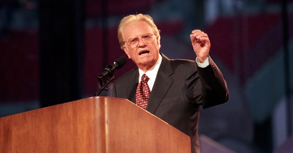 "Facebook/Billy Graham -- Billy Graham preaching during one of his many ""crusades."""