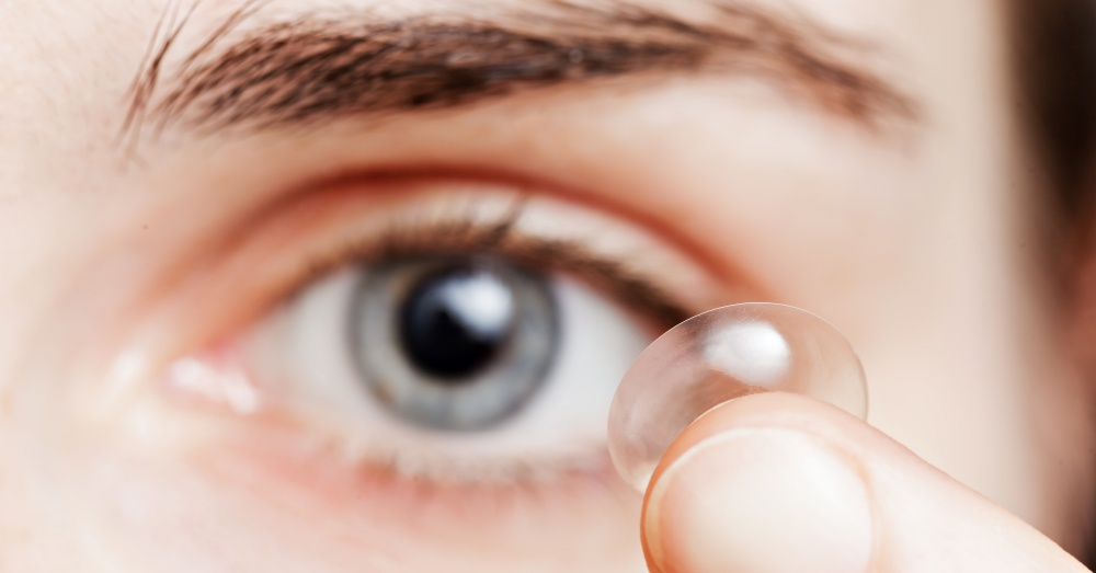 Close up of person about to put in contact lens
