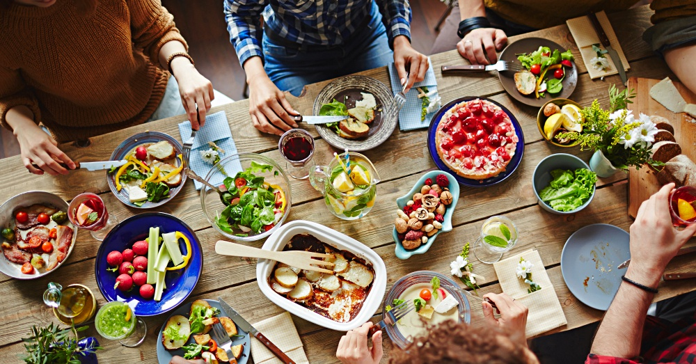 Top view of people sitting at a table eating healthy food