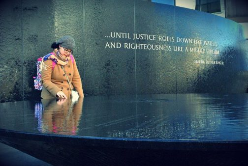 A woman pauses in reflection at the Marthin Luther King, Jr. memorial.