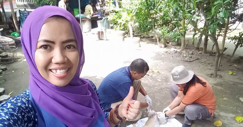 Source: Facebook/Desy MarlinaDesy Marlina poses with the animal care staff she's hired to help sterilize the dogs of Lombok.