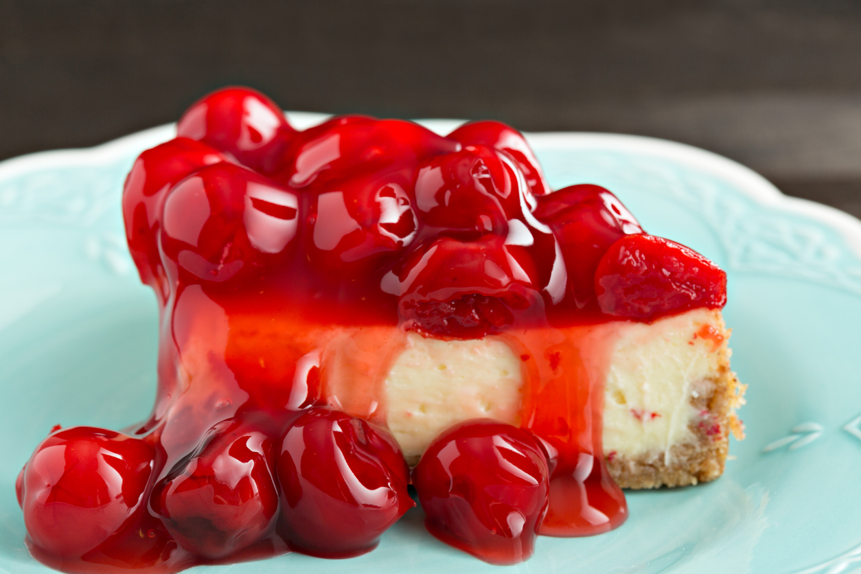 Slice Of Cherry Topped Cheesecake