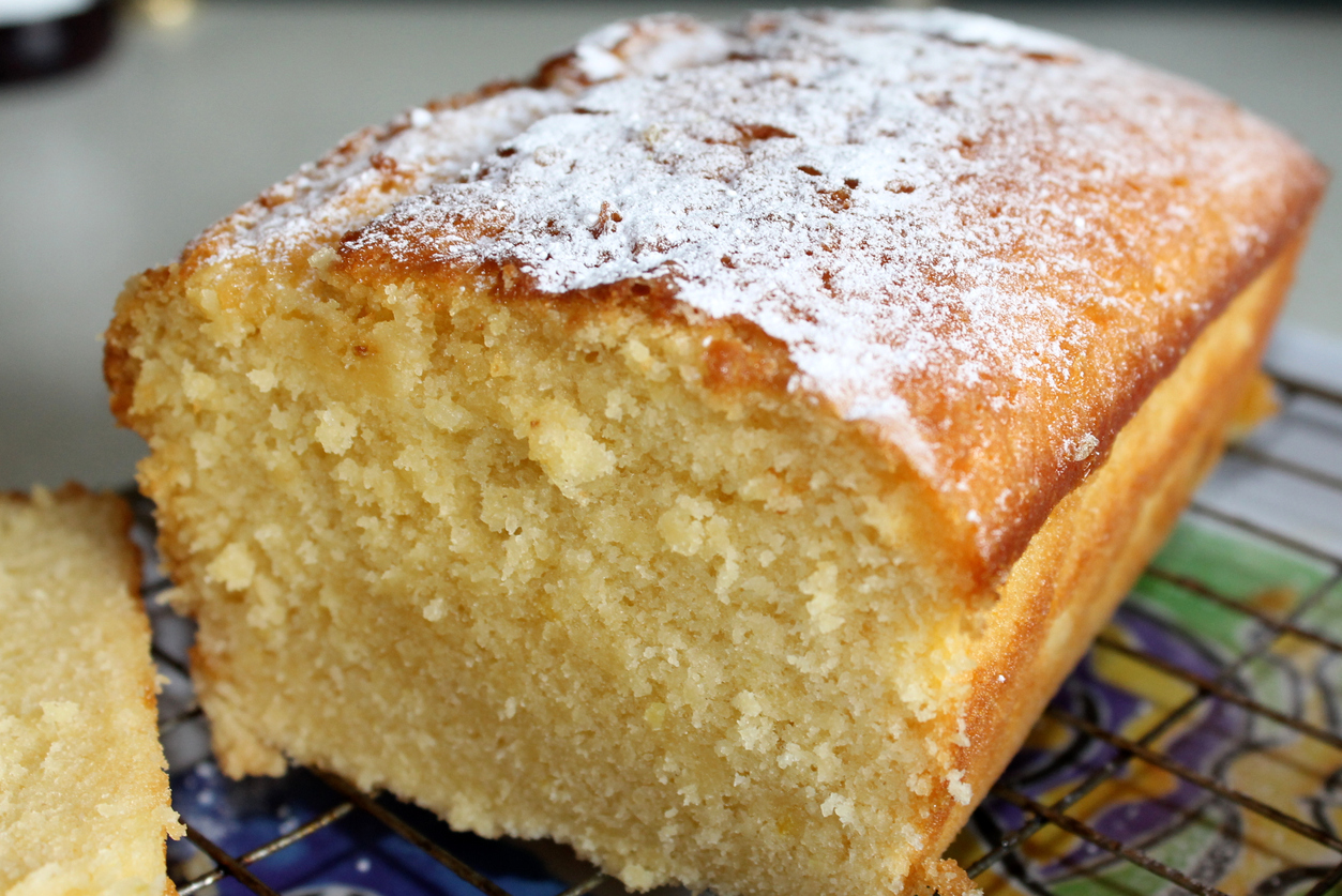 Homemade lemon drizzle loaf cake. Dusted with icing sugar and cooling on wire rack. Taken with a Canon 1100D SLR camera.