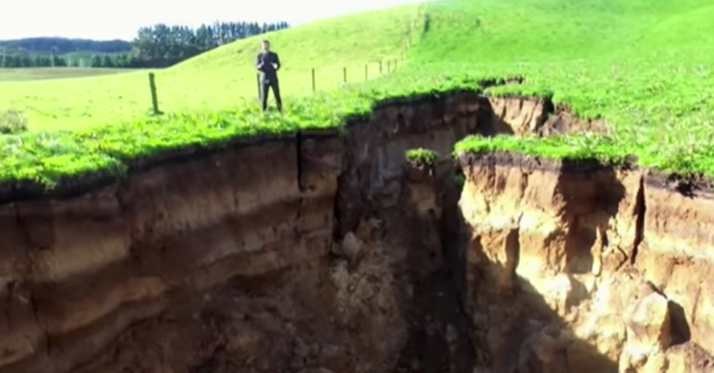 Source: YouTube/AFP news agency A newrby dairy farmer put a fence around the hole so his cows would not fall in.