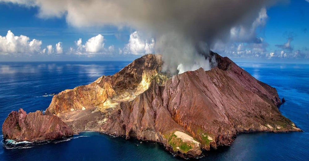 Source: Pixnio A strato volcano juts up from the ocean.
