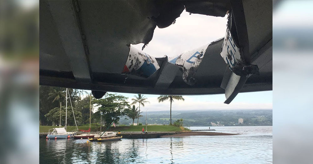 Source: YouTube/CBC News The hole in the boat's roof, made by lava.