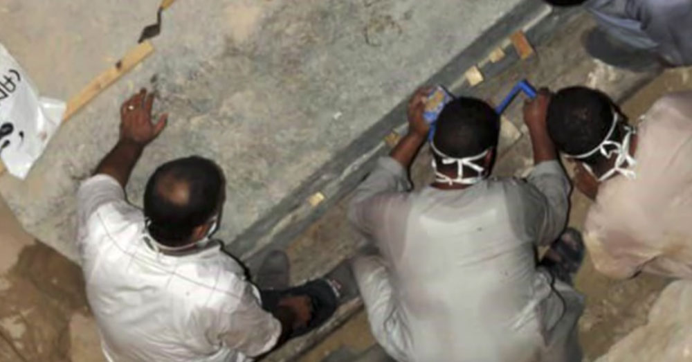 Source: YouTube/Ancient Architects Archaeologists break the mortar seal on the tomb.