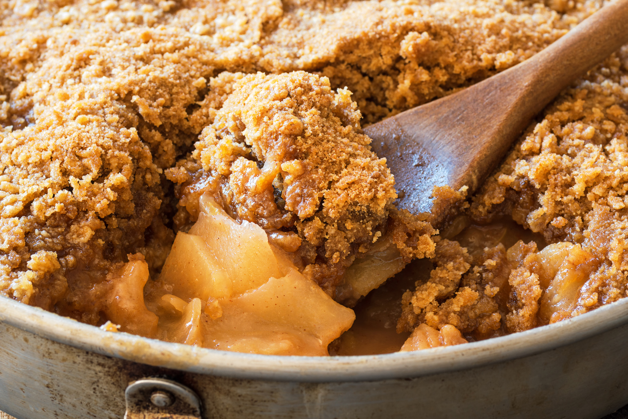 Detail of Spoonful of Apple Crisp or Apple Crumble Baked Dessert