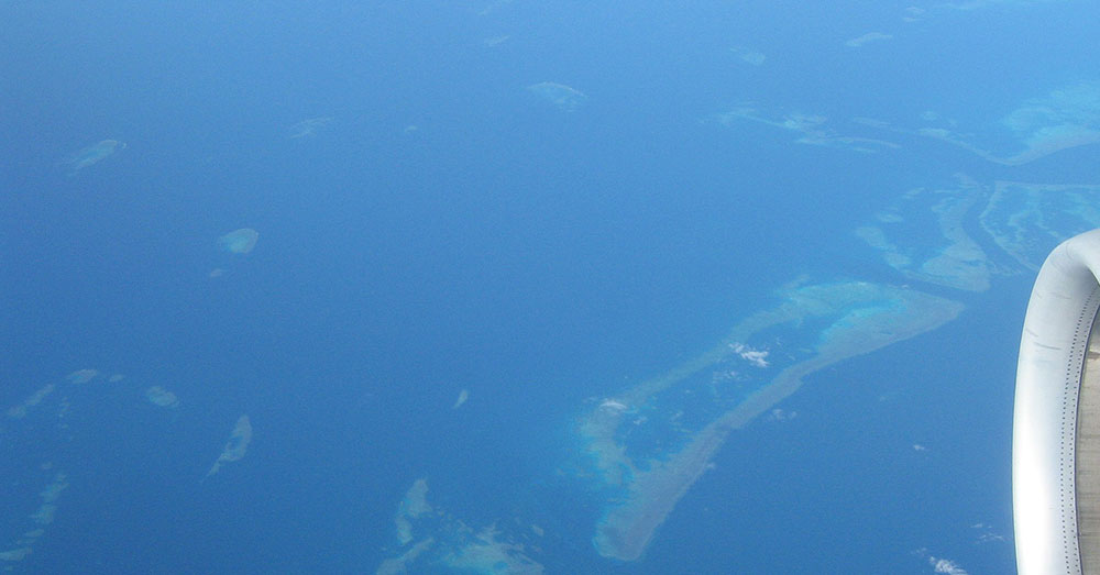 Source: Wikimedia Commons The Great Barrier Reef from an aircraft, thousands of miles above the Pacific Ocean.