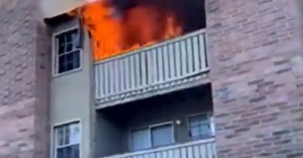 An apartment building on fire.