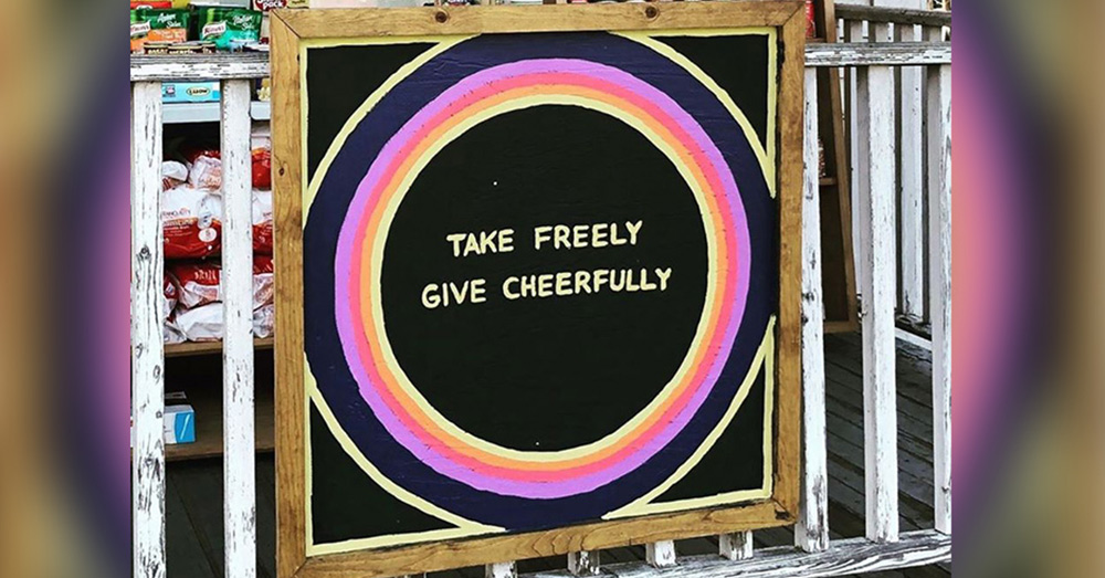 Take Freely Give Cheerfully reads the sign at the YpsilantiU-Access Community Pantry.