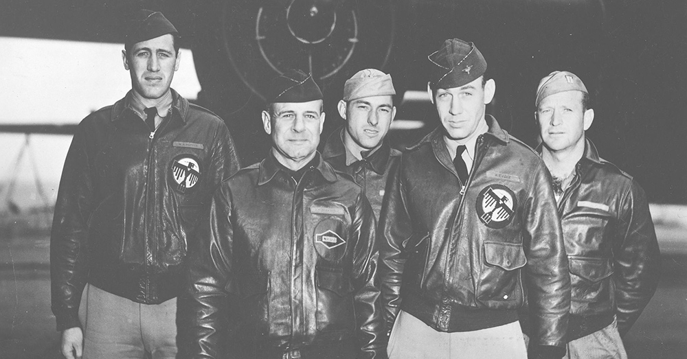 Crew No. 1 in front of B-25#40-2344 on the deck of Hornet, 18 April 1942. From left to right: (front row) Lt. Col. Jimmy Doolittle, pilot; Lt. Richard E. Cole, copilot; (back row) Lt. Henry A. Potter, navigator; SSgt. Fred A. Braemer, bombardier; SSgt. Paul J. Leonard, flight engineer/gunner.