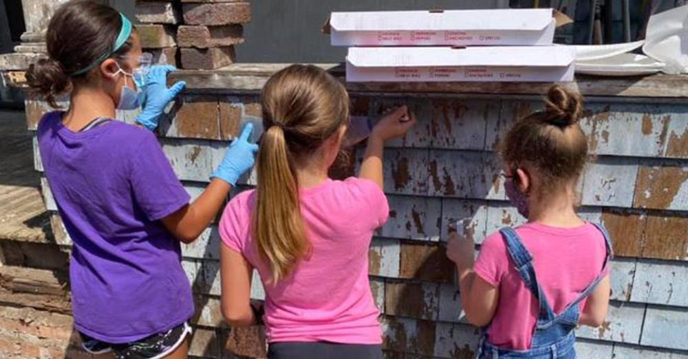 Neighborhood children helped paint Gloria's house.