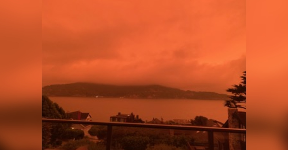 Wildfires create a nightmarish red sky.