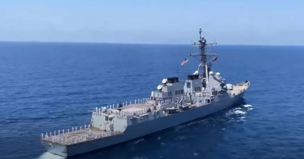 The guided-missile destroyer USS Winston S. Churchill (DDG 81) commemorates the 20th anniversary of the attack on the guided-missile destroyer USS Cole (DDG 67) .