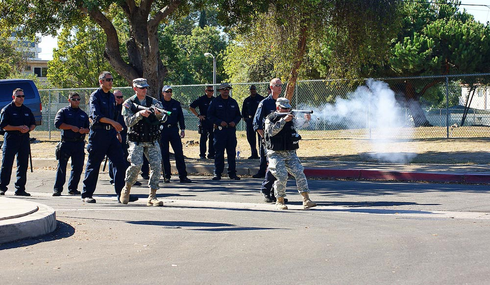 LAPD Metropolitan division officers train the 330th military police company of the California Army National Guard in the use of tear gas to control riots.