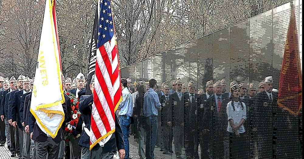 Veterans visit the Vietnam Veterans Memorial Wall.