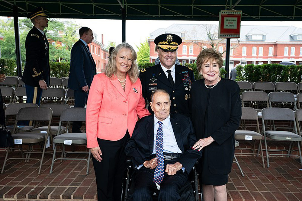 Army Gen. Mark A. Milley and Mrs. Hollyanne Milley pose for a photo with retired Sen. Bob Dole after an Armed Forces Welcome Ceremony.