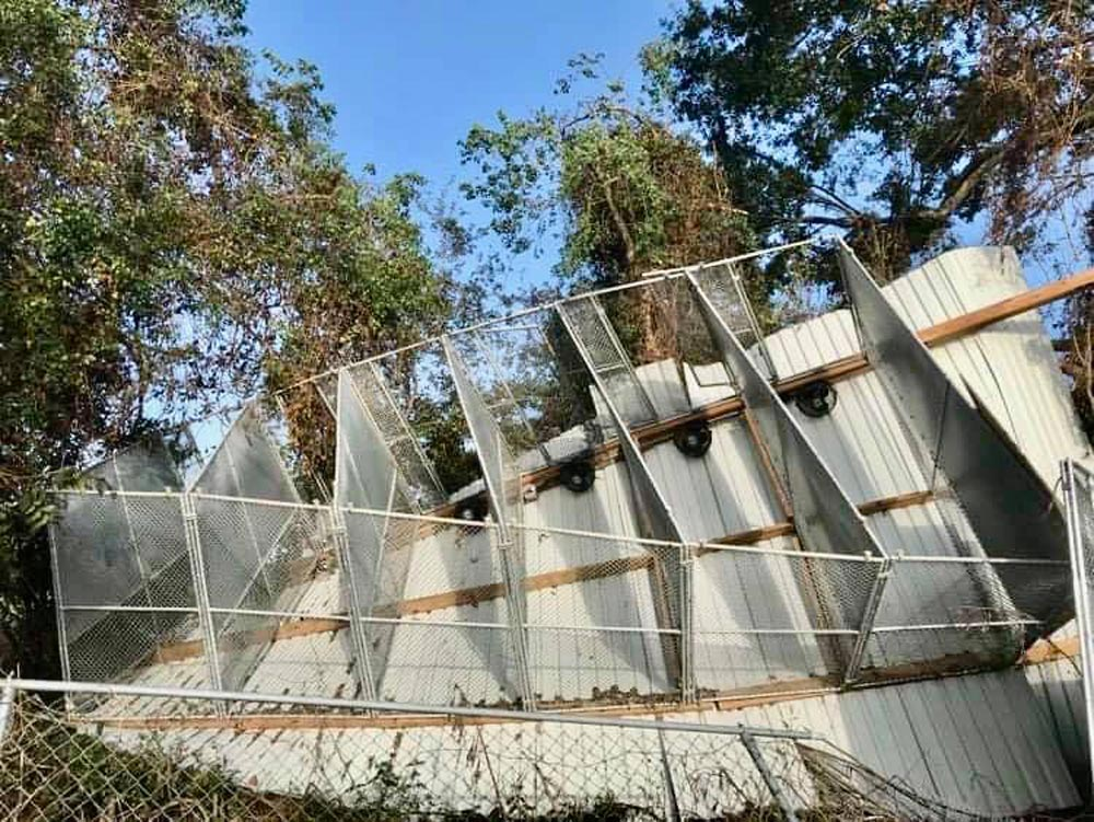 A wall of kennels blown off by Hurricane Delta.