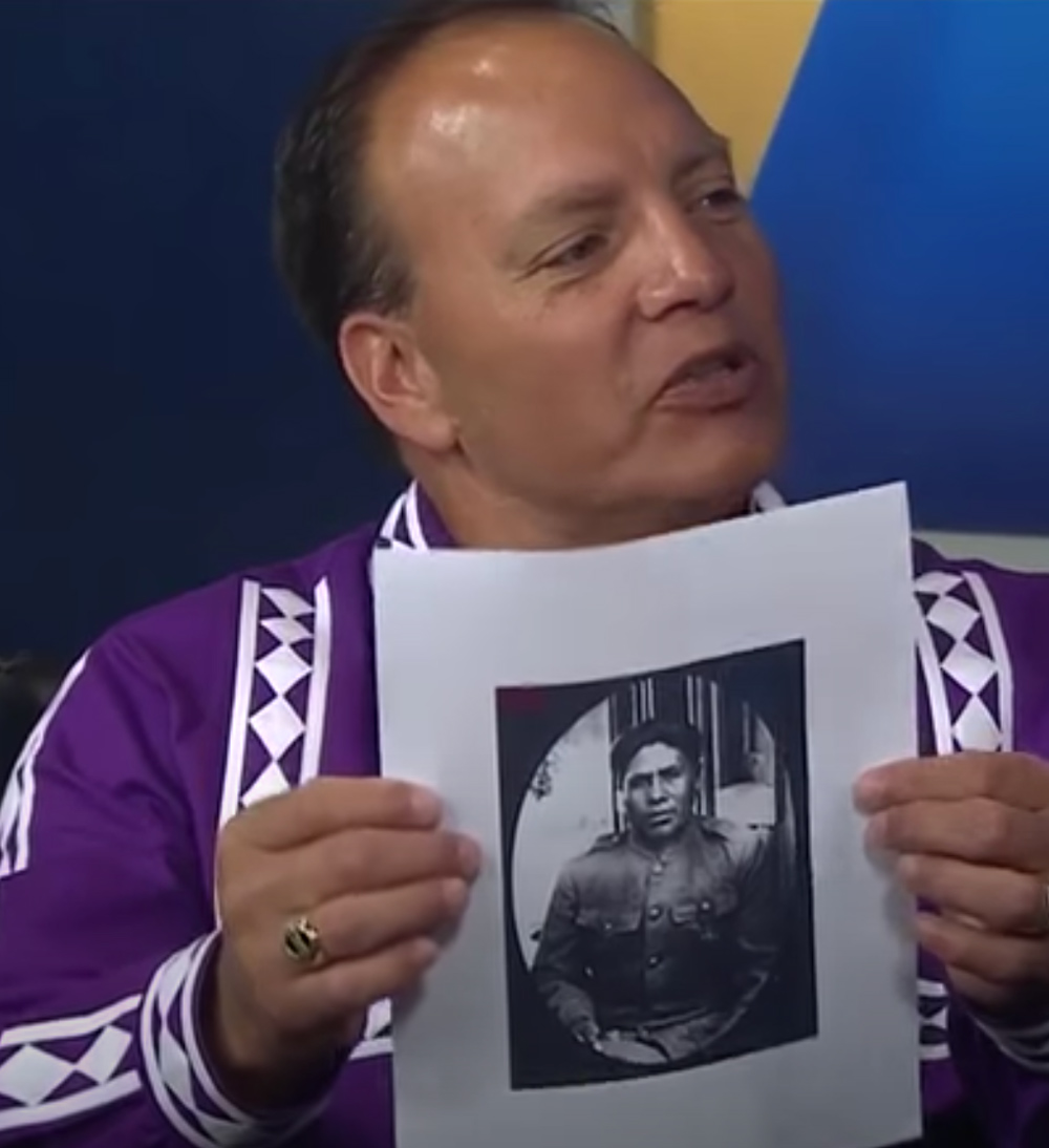Chief Batton holds an image of Joseph Oklahombi.